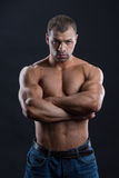 Handsome powerful bodybuilder with stern look. Close up of the Powerful bodybuilder with stern look Stock Photo