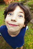 Handsome preteen boy expressive foreshortening portrait Royalty Free Stock Photos