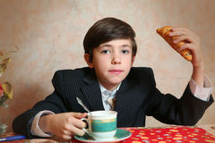 Handsome preteen boy play with croissan imagine its a  sheep Stock Photo