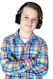 Handsome preteen boy smiling headphones with his arms folded Stock Photo