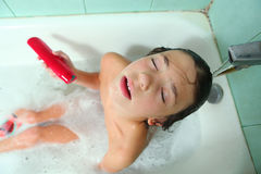 Handsome preteen boy take soap bath Royalty Free Stock Images