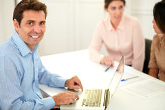 Handsome professional guy smiling at you Royalty Free Stock Photo