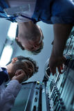 Handsome professional technicians working together Royalty Free Stock Photography
