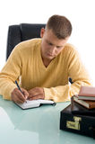 Handsome professional writing Stock Images