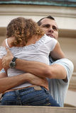 Handsome proud man hugging woman close on balcony Royalty Free Stock Photography