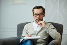 Handsome psychologist at work stock photos