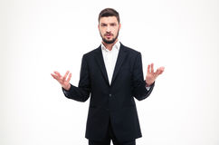 Handsome puzzled businessman with beard holding copyspace in both hands Royalty Free Stock Images