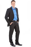 Handsome relaxed young man in a suit Royalty Free Stock Image