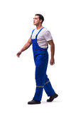 The handsome repairman wearing blue coveralls on white Stock Images