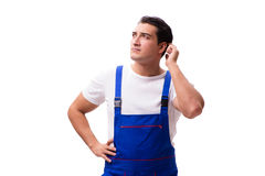 The handsome repairman wearing blue coveralls on white Royalty Free Stock Photography