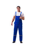 The handsome repairman wearing blue coveralls on white Royalty Free Stock Image