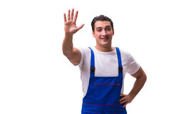 The handsome repairman wearing blue coveralls on white Stock Photo