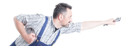 Handsome repairman with wrench in flying position acting like su Royalty Free Stock Photography