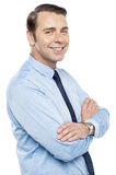 Handsome representative posing with folded arms Royalty Free Stock Image