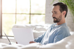 Handsome responsible man working on a laptop Royalty Free Stock Images