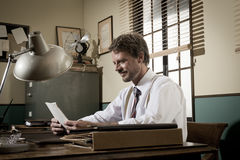 Handsome retro businessman reading a document Royalty Free Stock Photos