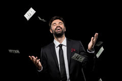 Handsome rich excited businessman throwing dollar banknotes, Stock Photos