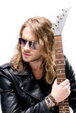 Handsome rocker in sunglasses posing with electric guitar isolated on white Stock Images