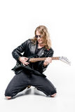 Handsome rocker in sunglasses posing playing electric guitar isolated on white Stock Photos