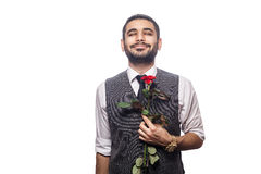 Handsome romantic happy man with rose flower. Stock Photo