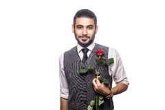 Handsome romantic happy man with rose flower. Stock Image