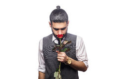Handsome romantic happy man with rose flower. Stock Images