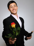 Handsome romantic man with rose flower and vine Royalty Free Stock Images