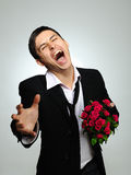 Handsome romantic man with rose flower and vine Royalty Free Stock Photos