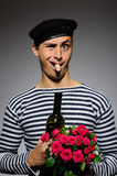 Handsome romantic man with rose flower and vine Royalty Free Stock Image