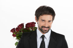 Handsome with roses. stock images