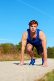 Handsome runner man at the start Royalty Free Stock Photo