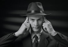 Handsome 1950s style man touching his head Royalty Free Stock Image