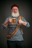 Handsome sailor isolated. Seaman with beer Royalty Free Stock Image