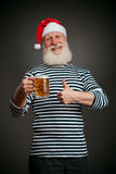 Handsome sailor. Seaman. Santa claus with beer Royalty Free Stock Photography