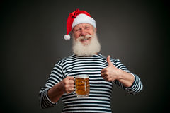 Handsome sailor. Seaman. Santa claus with beer Stock Photo