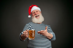 Handsome sailor. Seaman. Santa claus with beer Stock Image