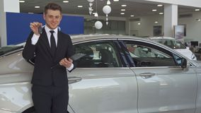 Sales manager shows key at the dealership stock image