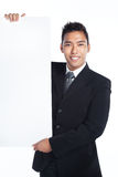 Handsome salesman, businessman with blank placard Stock Image