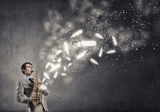 Handsome saxophonist. Concept image royalty free stock photography