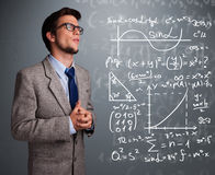 Handsome school boy thinking about complex mathematical signs Stock Images