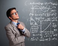 Handsome school boy thinking about complex mathematical signs Stock Photography