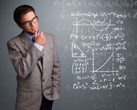 Handsome school boy thinking about complex mathematical signs Royalty Free Stock Photos