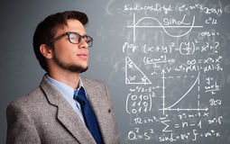 Handsome school boy thinking about complex mathematical signs Stock Photos