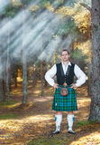 Handsome scottish man in the forest Royalty Free Stock Image