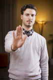 Handsome, seerious young man doing stop sign with hand Stock Photos