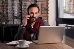 Handsome self employed businessman speaking on the phone Royalty Free Stock Photos