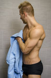 Handsome semi-naked young man in bathroom with Royalty Free Stock Photography