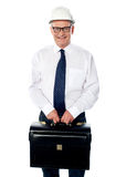 Handsome senior builder holding briefcase Royalty Free Stock Photos