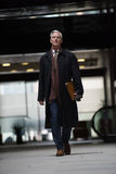 Handsome senior business man walking Royalty Free Stock Images