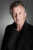 Handsome Senior Male against Grey Stock Photo